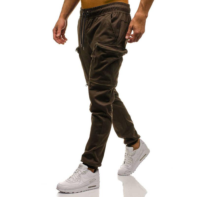 Plus rozmiar 3XL odzież sportowa do biegania spodnie treningowe męskie spodnie sportowe spodnie joggingowe mężczyźni szybkie suche budowy ciała Fitness Cargo spodnie Harem
