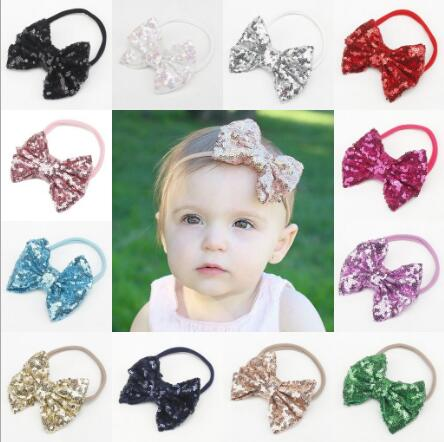 все цены на 1pcs New baby girl boy spandex nylon headband children skinny stretchy Non-Marking headwear Glitter Bowknot elastic hair Band онлайн