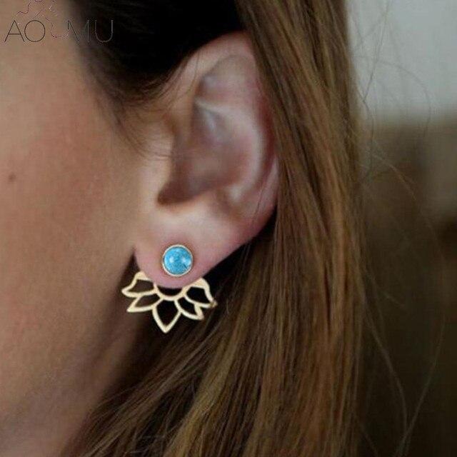 gouden oorbellen met blauwe steen