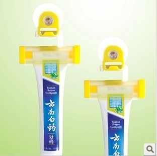 1 個の有用なプラスチックローリング歯磨き粉簡単ディスペンサーホーム浴室ホルダーアクセサリーガジェット