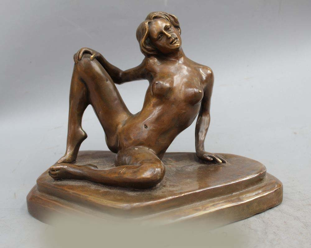 An erotic bronze sculpture of a reclining male nude