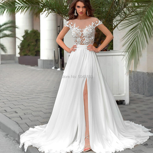 Image 1 - Side Slit A Line Boho Wedding Dresses Sexy Sheer High Neck Short Sleeves Chic Lace Appliques Chiffon Bridal Gowns Buttons Back