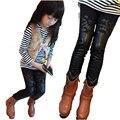 Осень и зима новый детская одежда толщиной лоскутные девушки леггинсы выдалбливают цветок искусственного кожаные штаны толстые большие девушки bootcut
