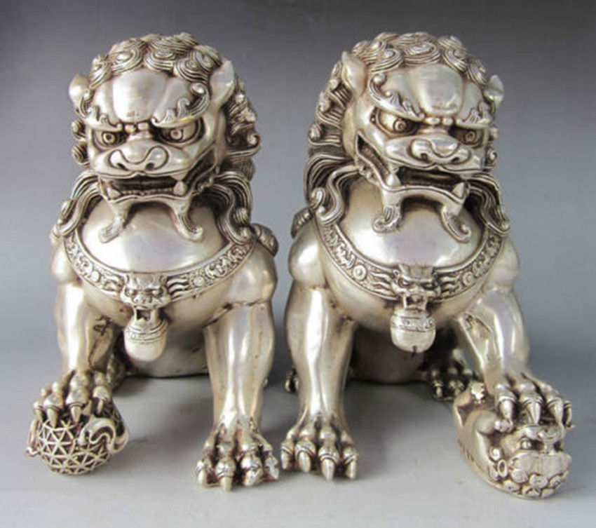 A Pair of Chinese Silver Guardian Lion Foo Fu Dog StatuesA Pair of Chinese Silver Guardian Lion Foo Fu Dog Statues