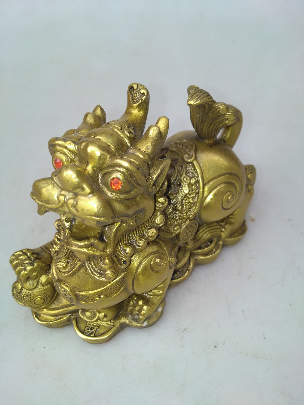 Chinese hand carved brass money beast a pair of sculpturesChinese hand carved brass money beast a pair of sculptures