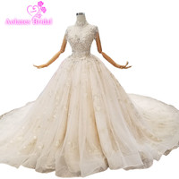 2018 Champagne Tulle Bead Lace Sleeveless High Neck Cathedral Train Bridal Gowns Backless Ball Gown Illusion Wedding Dresses