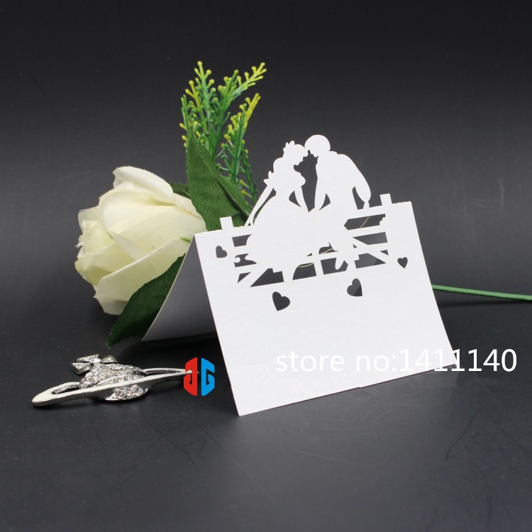 wedding place card bride and groom sit on the Fences laser cut table name card number place card wedding party decorations