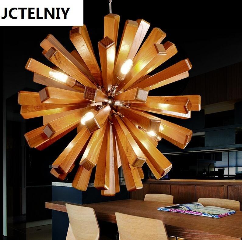 купить Solid wood chandelier modern Nordic creative minimalist living room dining wooden lamp по цене 23255.15 рублей