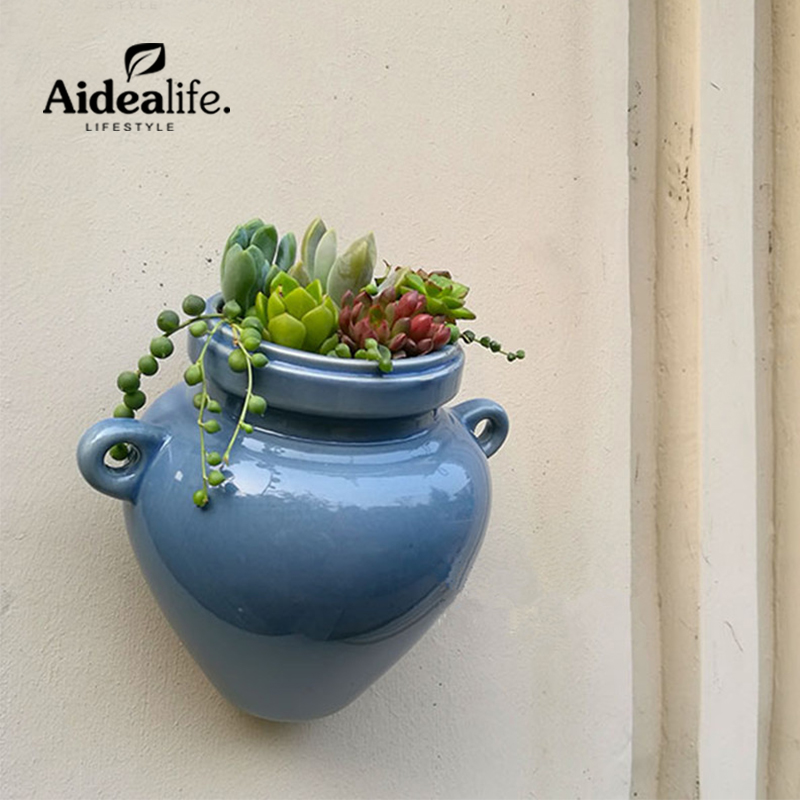 Ceramic wall planters planters for succulents blue ceramic for Decorative hanging pots