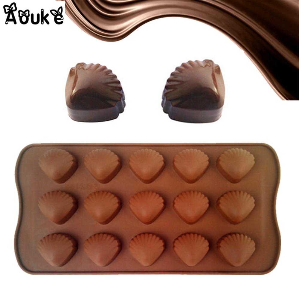 Compra en forma de concha de chocolate online al por mayor de ...