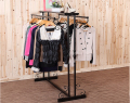 wrought iron clothes rack. Floor type clothing store shelves.