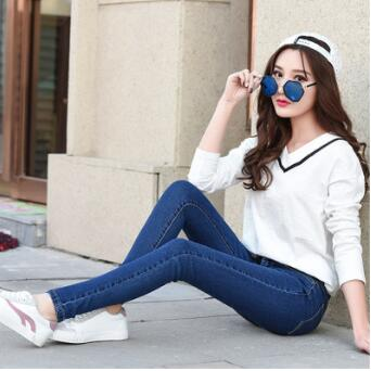 2018 spring female new light-colored hole flanging long pants jeans women