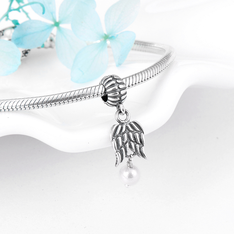 Sterling Silver and Pearl Bracelet with Angel Wings Linked with Pearls
