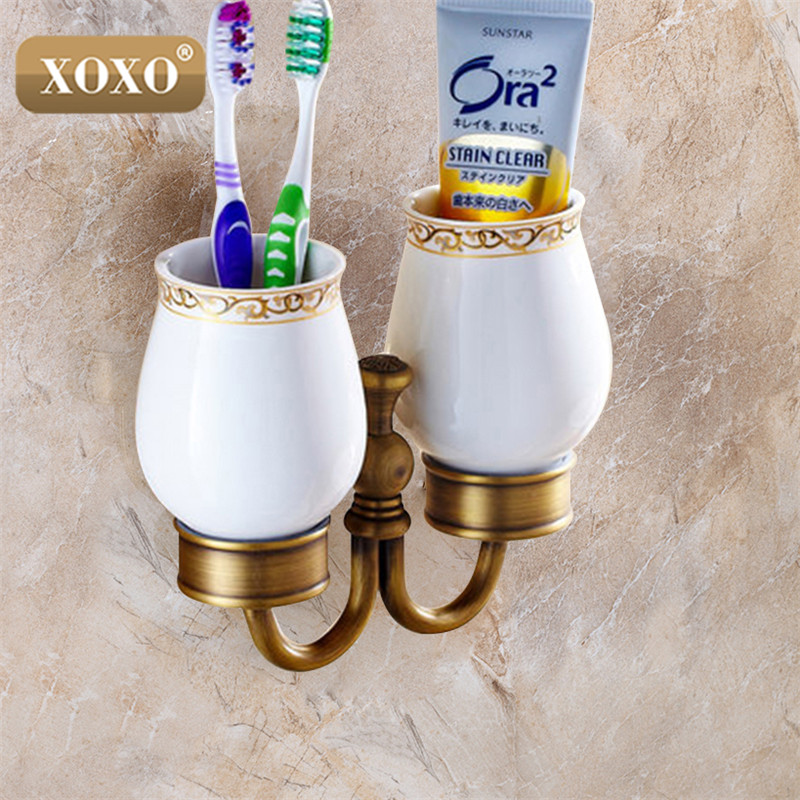 XOXO New arrival Brass antique tumbler holder cup&tumbler holders tumbler toothbrush holder bathroom accessories 20084DB cup & tumbler holders glass cup brass antique toothbrush cup holder set luxury bathroom accessories wall tumbler holders 10703f