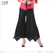 Фотография High-end fashion women Miyake Pleats wide leg pants Big yards loose solid color irregular elastic waist fold pantyhose