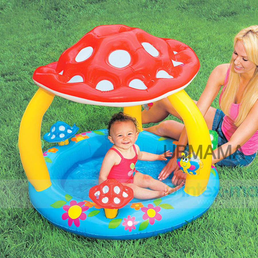 Children at the bottom of an inflatable swimming pool with baby mushroom awning pool sea pool basin