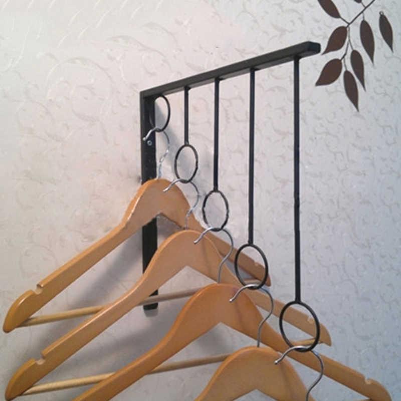เหล็ก5แหวนติดผนังเสื้อผ้าที่แขวนสำหรับการตัดเย็บเสื้อผ้าผ้าพันคอกระเป๋าถือจอแสดงผลร้าน