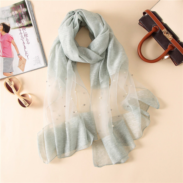 da7675b7e 2017 wholesale new silk root yarn scarf women decorated with luxury solid  color scarf outdoor travel sunscreen shawl beach towel