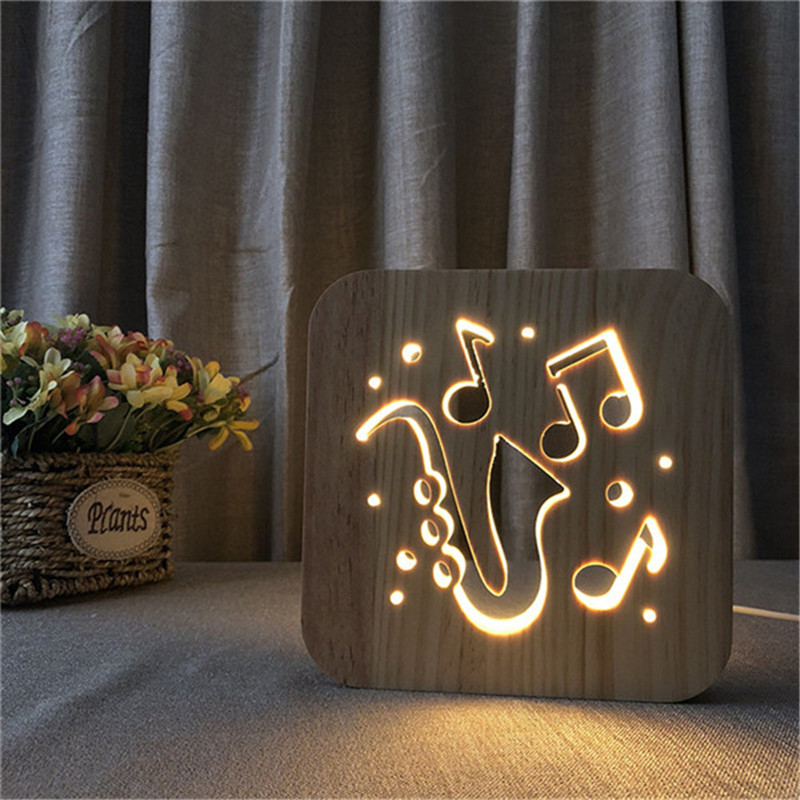 цена на Musical Saxophone Hollow Design Wooden 3D Night Lamp Warm White LED USB lamp as Creative Gift or Hotel Decor Drop Shipping