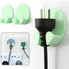 050 2pcs Home kitchen plug hook Office Wall Adhesive Plastic Power Plug Socket Holder Hanger Storage Hook 6*5*2.5cm