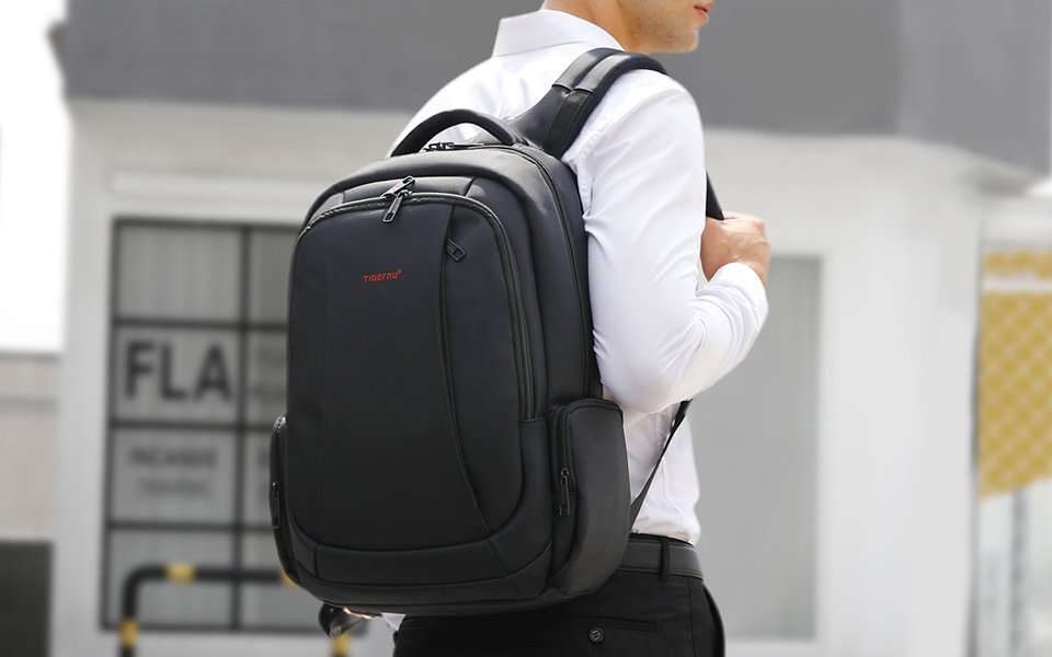 Spacious 15.6 inch Laptop Travel Backpacks in the back of a man