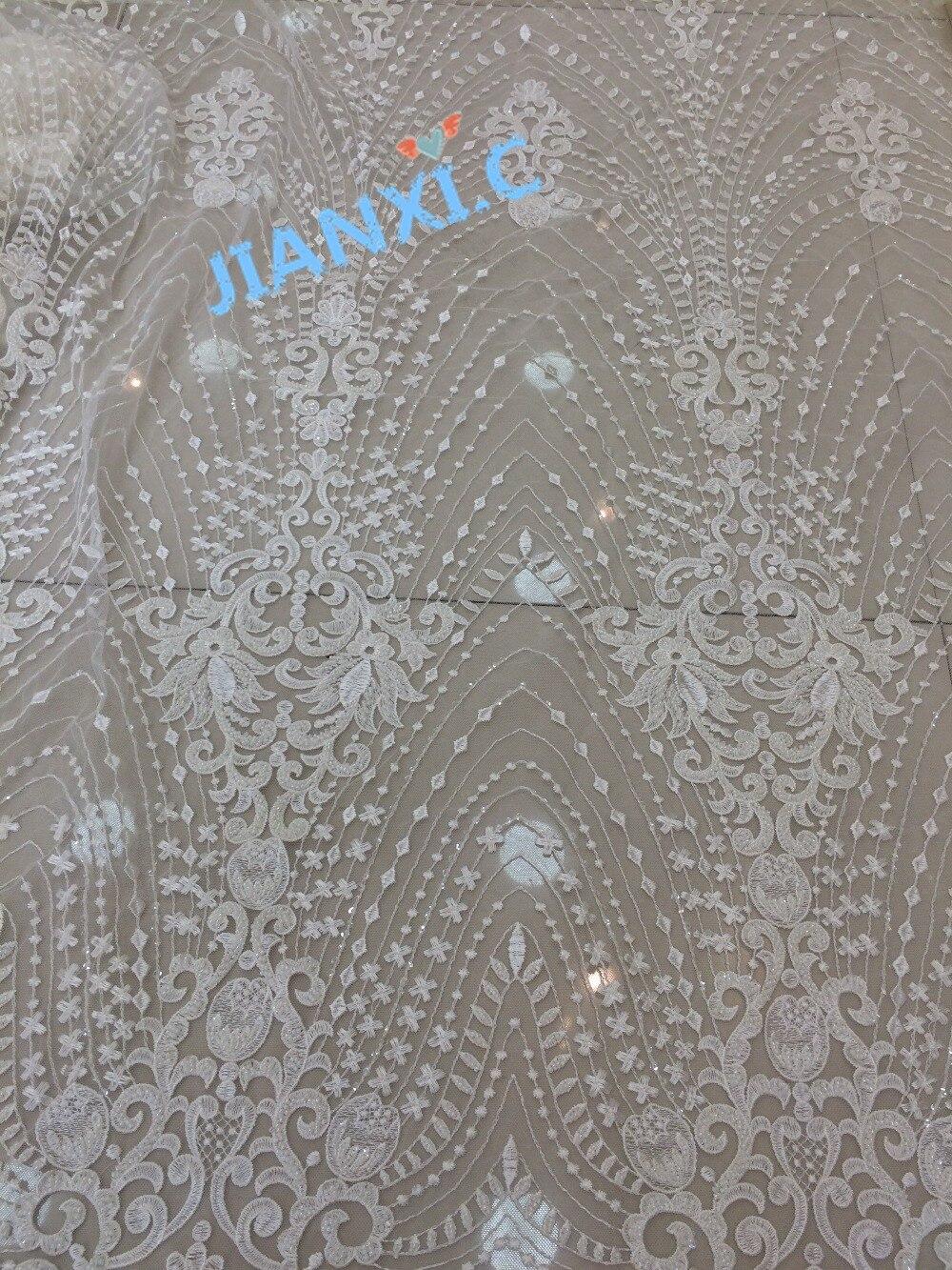 Nuovo design David 61612 pizzo ricamato netto di alta Qualità francese Tessuto di Pizzo netto con perline complete per il vestito da sposa-in Pizzo da Casa e giardino su  Gruppo 1