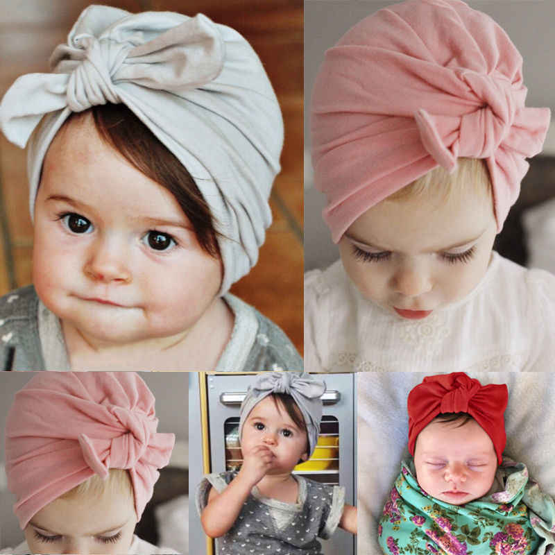 Nuevo estilo niño niñas gorro sombrero recién nacido chico niño niña Infante Bowknot sombrero sólido niño algodón gorro gorra caliente, de moda, 2019