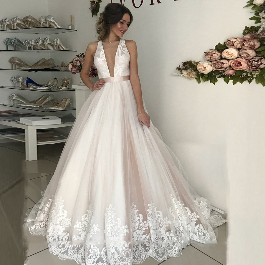 Plunging Illusion Tulle Neck Lace Wedding Dress with A Belt Criss Cross Court Train Applique Edge