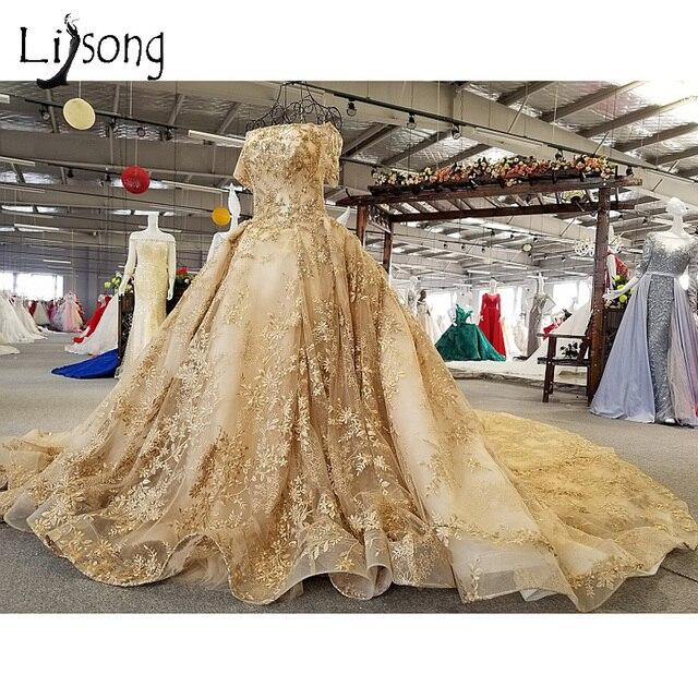 Dubai Luxury Golden Wedding Dresses With Overskirt Crystal Beaded Lace Bridal Gowns Saudi Arabic Half Sleeves
