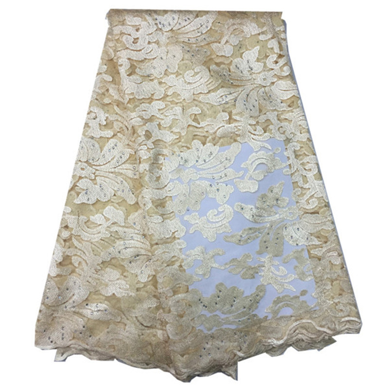 Cream color hot sale african french net lace fabric with stone for wedding dress