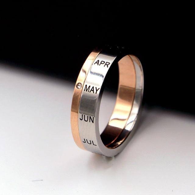 Фото кольцо из титановой стали с буквами розовое золото и серебро цена