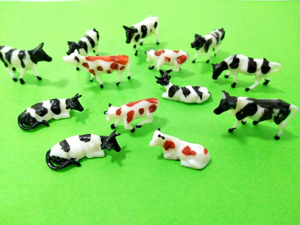 Teraysun 100pcs HO Scale painted Farm Animals Cows Mixed Scale Cow Model for Model Railway Scenery Layout