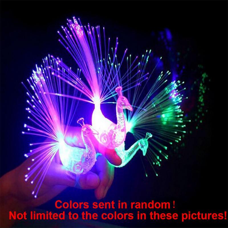 Venda quente das Crianças Light-emitting Brinquedos Infantis Coloridos Cor Pavão Forma Dedo Lâmpada Anel de Luz Dedo Luminoso Luminosa