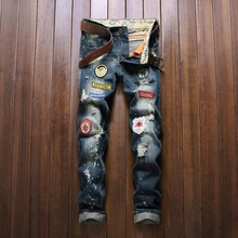 2016 new mens locomotive jeans ripped Jeans Cool Patchwork Badge Men's casual Denim Jeans Skinny Pencil Pants hiphop jeans