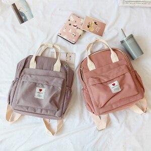 Image 2 - Güney kore güzel Ins yumuşak çantası kadın öğrenci japon Harajuku sırt çantası küçük taze Ulzzang mor sırt çantası