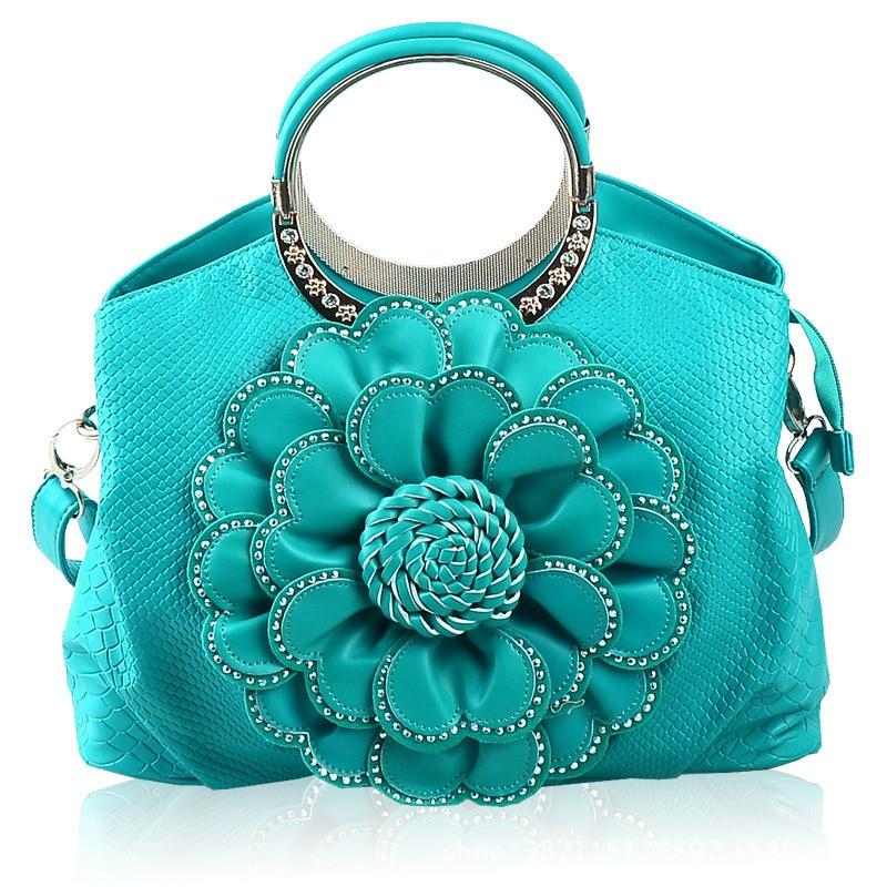 Rose woman pack 2016 new pattern portable Shoulder Handbag trend of female national wind to make the bag