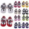 De alta calidad súper suave suela inferior unisex zapatos de bebé de cuero infantil bowknot borla decoración primer caminante zapatos 0-18 m