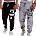 Corredores dos homens 2017 Marca Masculino Casual Calças de Algodão Calças Dos Homens Casual Letra Impressa Sweatpants Jogger Sportwear Plus Size 4XL