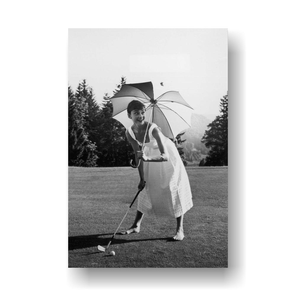 Audrey Hepburn-Classic photo Audrey Hepburn is playing golf, Movie Poster Print, 24 by 36-Inch image