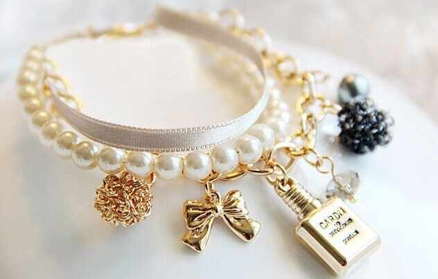 The new perfume bottle for girls is decorated with pearl ribbon crystal bracelet with bow