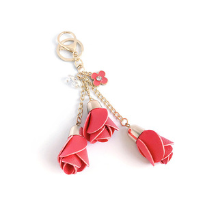 Image 3 - Dhlfree 100pcs 18 색 매력 가죽 장미 꽃 열쇠 고리 술 꽃 열쇠 고리 여성 열쇠 고리 가방 지갑 펜던트 쥬얼리
