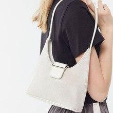 Niche summer simple wild canvas woman bag Tot dumplings under the shoulder bag 2019 new button handbag