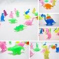 50 Pçs/lote dinossauro Dos Desenhos Animados Figuras de Ação brinquedos Otário crianças Mini Copo de Sucção Coletor Capsule toy modelo para crianças
