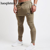FASHION MEN NEW CASUAL JOGGER PANTS BODYBUILDING GYMS CLOTHES FASHION BRAND JOINING TOGETHER PENCIL PANTS SPORTWEAR