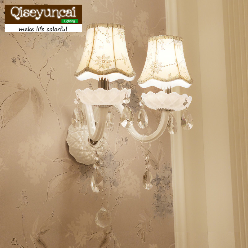 все цены на Qiseyuncai Simple European crystal wall lamp simple bedroom bedside lamp European style living room aisle lights онлайн