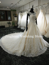 100% Real Picture Wedding Dresses 2016 Hand-Beading Long train Bridal Gowns Appliques Lace Backless Bridal Gown