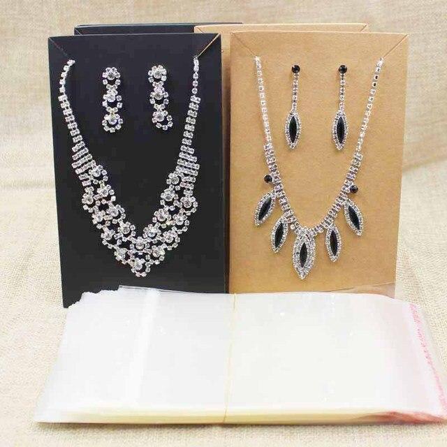 15.5*9.5 cm zwart/kraft grote kostuum ketting met oorbel card grote sieraden set pakket tonen kaart 100 stks + 100 wedstrijd tas