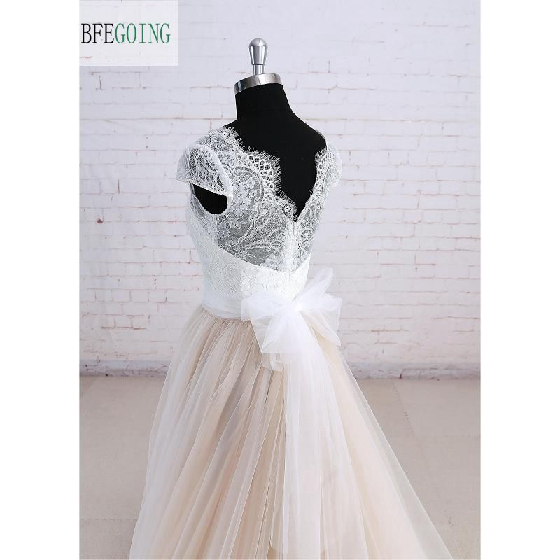 Ivory Floor Length Tulle V-neck Cap Sleeve A Line Lace Wedding Dress
