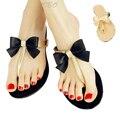 2015 Летнние обуви Сладкие туфли  Женская новинка  Вьетнамки лука с блеском  и т ремнями  Плоские сандалии Пляжная обувь Черный абрикос цвета