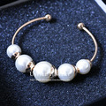 USTYLE Fashion Simulated Simply Freshwater White Pearl  Bangle Bracelet for Women UB0043